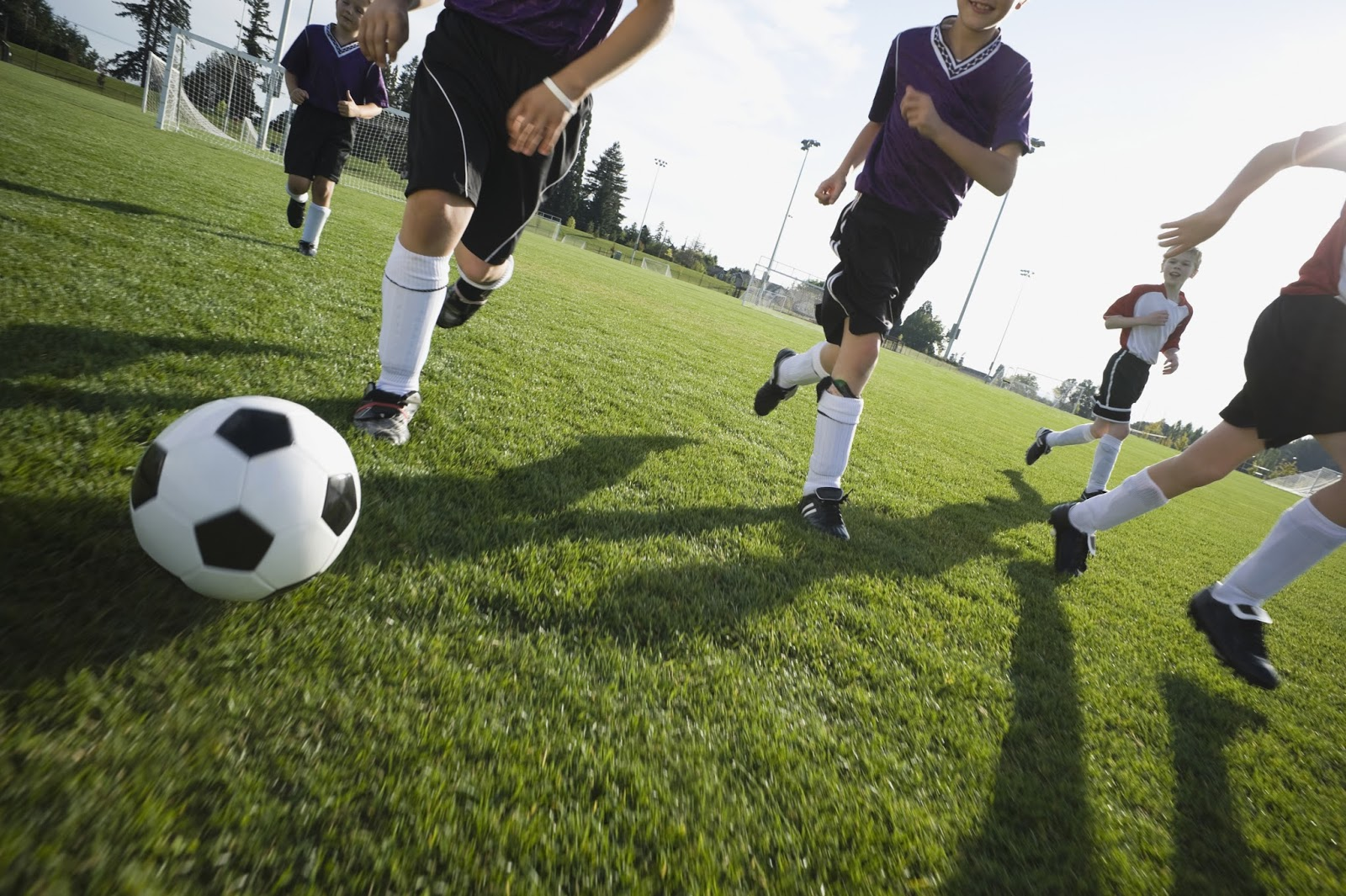 Boys playing competitive soccer
